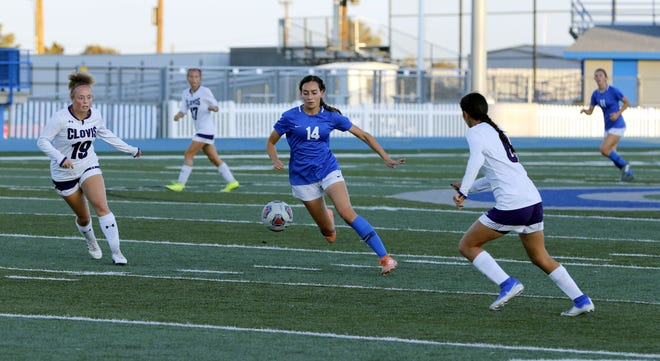 Carlsbad's Makenzie Kleinstruber dribbles between two Clovis defenders on Oct. 15, 2019. She scored the only goal of the game allowing Carlsbad to win in double overtime, 1-0.