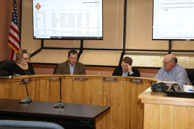 From left:Eddy County Commissioners Susan Crockett, Steve McCutcheon, Jon Henry and Ernie Carlson discuss Eddy County business during an Oct. 15 meeting in Carlsbad. Commissioners approved a bid award of $27,455 to Artesia Ford for an evidence van for the Eddy County Sheriff's office.