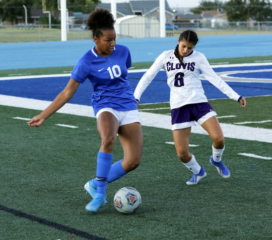 Carlsbad's Allie Myers keeps the ball away from Clovis' Nevaeh Coronado while Myers looks for a scoring opportunity.