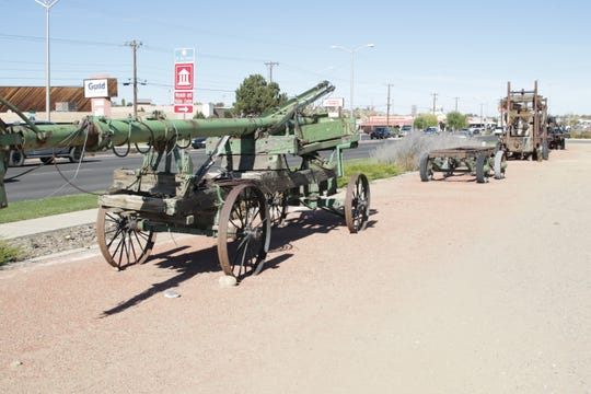 Antique oilfield equipment is displayed at the front of the proposed Gateway West Development on East Main Street.