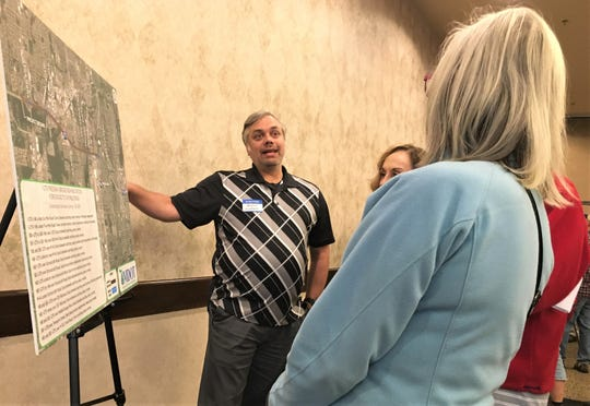 Residents at the meeting talked to MDOT employees about the project's details.