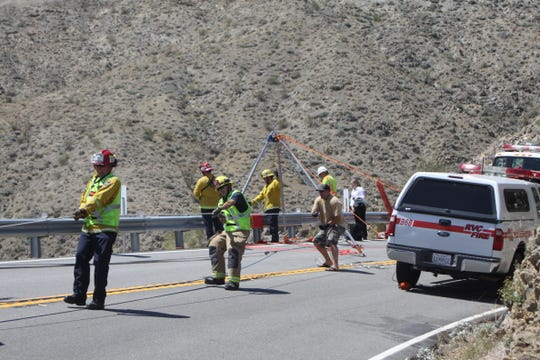 This file photo shows rescue crews retrieve a child who was killed in a Highway 74 crash on May 1, 2016. Her mother pleaded guilty to one count of murder on Sept. 27, 2019.