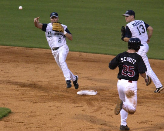 Pensacola Pelicans' Joe Espada (2) tags second base for the out as Carlos Mendoza (13) backs him up. Mendoza and Espada are coaching on opposite ends of the 2019 American League Championship Series.