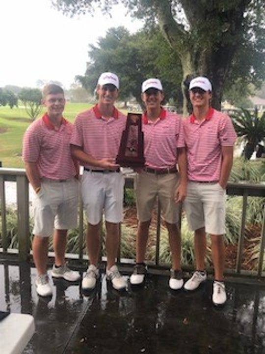 The Pace Patriots boys golf team celebrates its victory in the 2019 District 1-2A tournament on Monday at Stonebrook Golf Course.