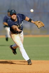 Pensacola's Joe Espada tosses the ball to second base during his playing career with the Pelicans in 2004.