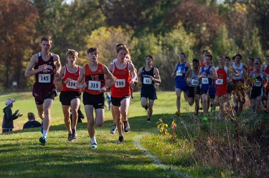 York Suburban's Cole Adams (319) leads the pack in the YAIAA cross country championships at Gettysburg Area High School on Tuesday, October 15, 2019.