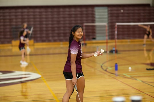 Kaitlin Tucay smiles after defeating Sandra Day O'Connor in a badminton match on Oct. 10, 2019 in Glendale, Ariz.