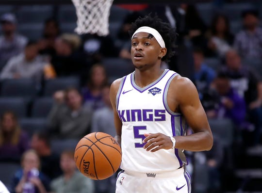 In this photo taken Oct. 10, 2019, Sacramento Kings guard De'Aaron Fox dribbles up court during the first quarter of an NBA preseason basketball game against the Phoenix Suns in Sacramento, Calif. Fox took a big leap in his second season, last year, making big improvements in his shooting, scoring, passing and defense. (AP Photo/Rich Pedroncelli)