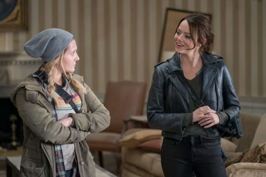 "Abigail Breslin (left) and Emma Stone star in ""Zombieland: Double Tap."""