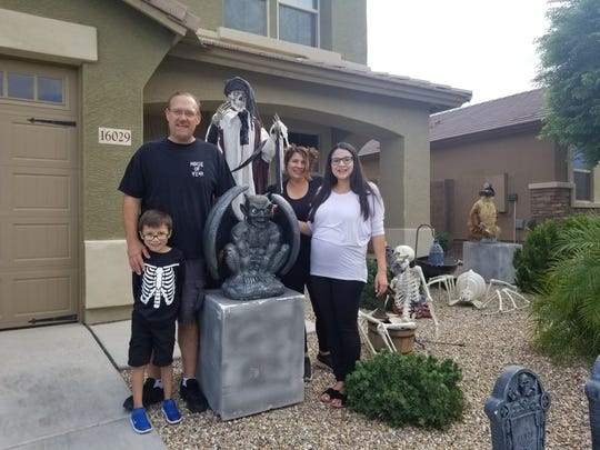 The Dehlinger/Real Family: Russ, Blanca, daughter Jessica and grandson Andres, stand in front of their Greer Ranch home in Surprise.