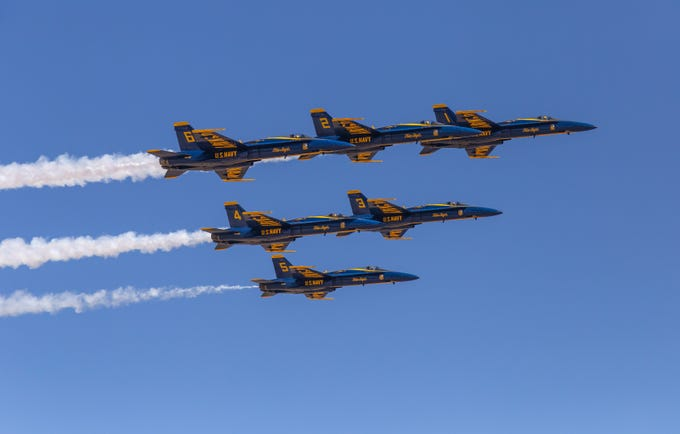 The U.S. Navy Blue Angels fly in formation over Phoenix-Mesa Gateway Airport.