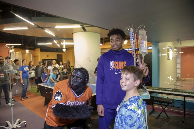 Phoenix Suns rookie Jalen Lecue with the Suns Gorilla visits patient Cody Grasso at Phoenix Children's Hospital.