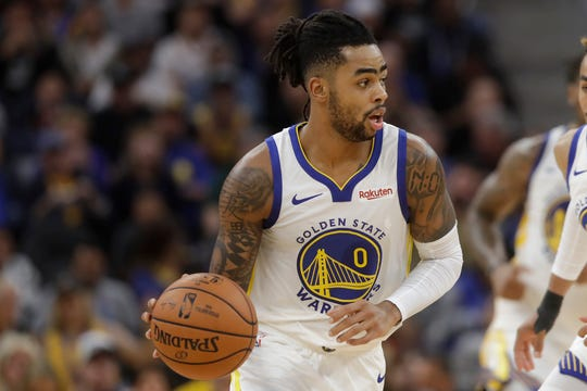 Golden State Warriors guard D'Angelo Russell dribbles against the Los Angeles Lakers during the first half of a preseason NBA basketball game in San Francisco, Saturday, Oct. 5, 2019. (AP Photo/Jeff Chiu)