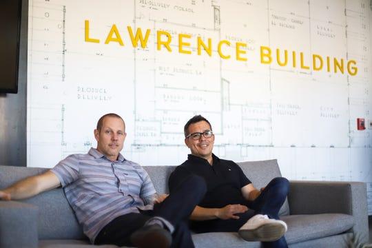 Troy Watson (left) and Kyu Utsunomiya (right) sit inside of The Larry in Phoenix, Ariz.