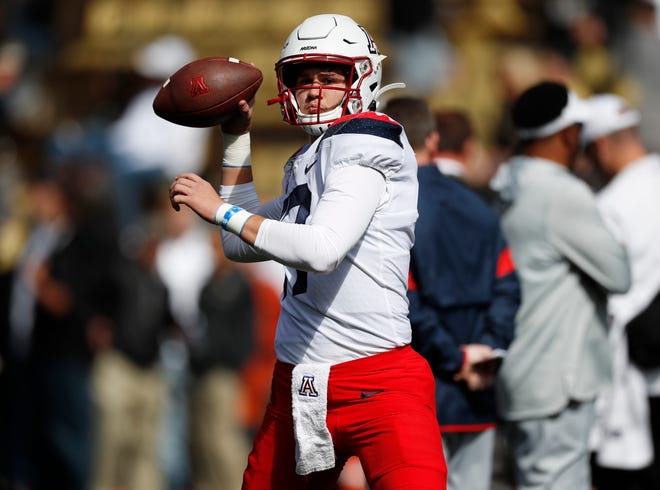 Arizona quarterback Grant Gunnell warms up before the first half of an NCAA college football game Saturday, Oct. 5, 2019, in Boulder, Colo.