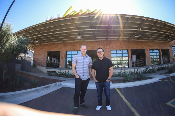 Troy Watson (left) and Kyu Utsunomiya (right) pose in-front of The Larry in Phoenix, Ariz.