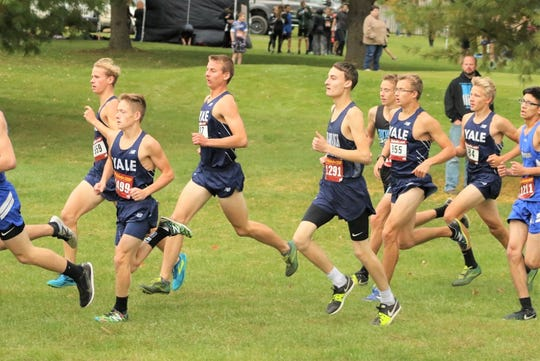 A pack of Yale boys cross country runners compete during the final Blue Water Area Conference jamboree Tuesday, Oct. 15, 2019, at Castle Creek Golf Course.