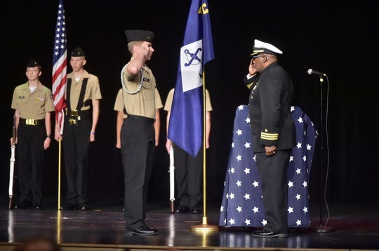 Commander Jimmie Miller, U.S. Navy (Ret)., NJROTC Area Four Manager, and Company Commander, Cadet Lieutenant Commander Ian Brown salute one another at the commissioning ceremony for the Navy Junior Reserve Officers Training Corps at Chambersburg Area Senior High School on Wednesday, Oct. 16, 2019.