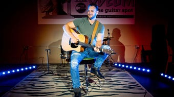 "York County singer-songwriter Garrett Shultz sings his song, entitled ""Beautiful"", at the Guitar Spot."