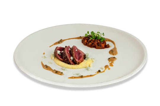 Seared venison loin is joined by Point Reyes blue cheese polenta.