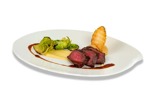 A strip loin of American Wagyu beef is sourced from Mishima Ranch.