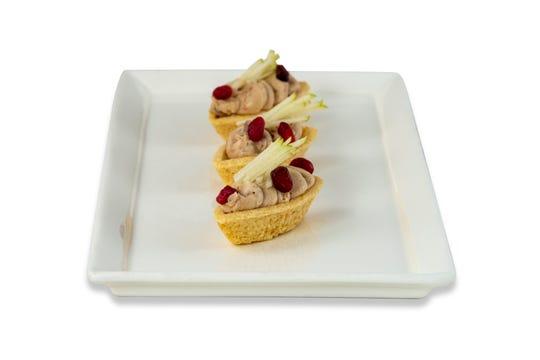 Autumn tartlets brim with foie gras mousse and topknots of Gravenstein apples.