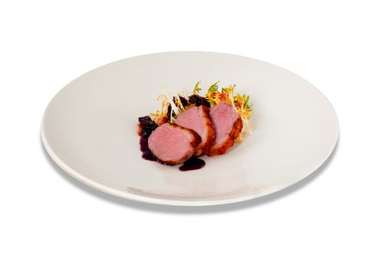 Smoked duck breast salad includes a tangle of frisée.