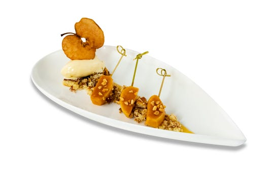 A baked apple is deconstructed into skewers and accompanied by French vanilla gelato.