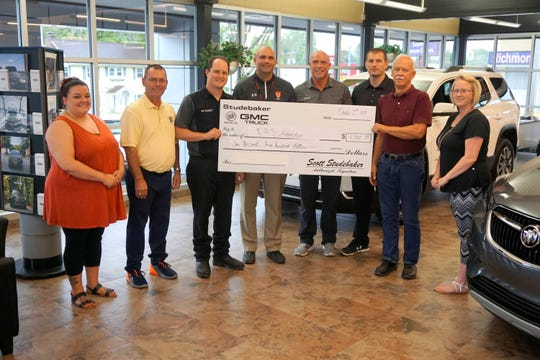 Studebaker Buick GMC Trucks, Inc. presents $2,500 raised through a car show to Richmond High School's Automotive Department. Pictured (from left) are Ashley Benkert, Mark Lasley, Josh Summey, Rusty Henlsey, Scott Studebaker, Justin Hall, Jim Creech and Tiffany McGinnis.