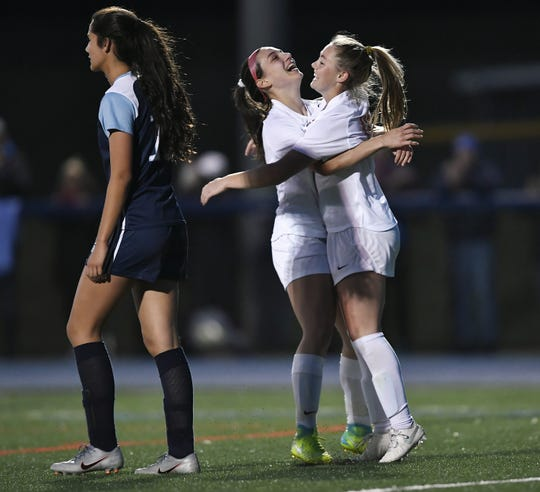 Marion's Chloe DeLyser, right, celebrates with Scarlett Keppen after DeLyser scored her 317th career goal during a game against Gananda at Gananda High School, Tuesday, Oct. 15, 2019. Marion beat Gananda 7-0.
