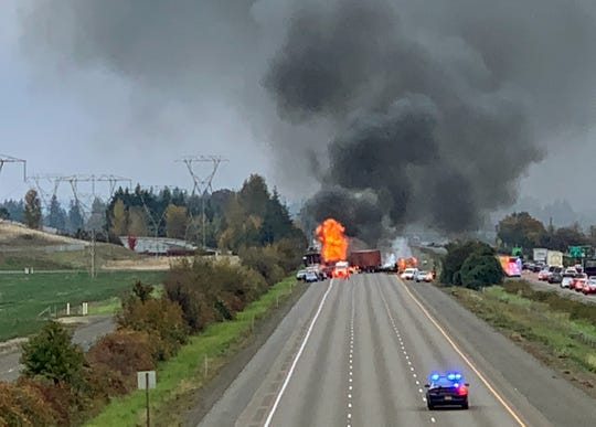 A fiery crash with two semi-trucks has closed southbound Interstate 5 closed two miles north of Woodburn.