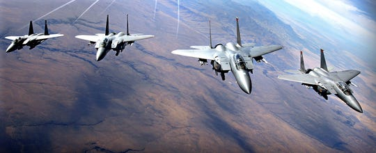 This file photo shows a group of U.S. Air Force F-15 aircraft flying in formation near Mountain Home Air Force Base, Idaho.