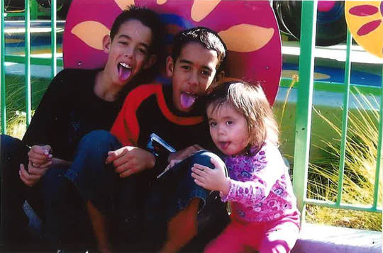 Here, Sal and his brother Dom pose with a little girl. Sal loved to babysit, his mother said.
