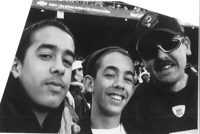 A photo of Sal with his brother Dom at a game.