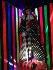 A scary clown looks down as passersby at Terror 29, Sioux Falls' newest haunted house.