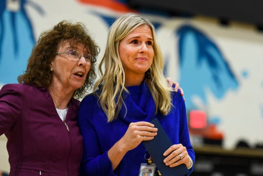 Alison Ter Horst is caught by surprise as she is awarded the 2019 Milken Educator Award of $25,000 on Wednesday, Oct. 16, 2019 at Washington High School. The award recognizes educators who are considered exemplary.