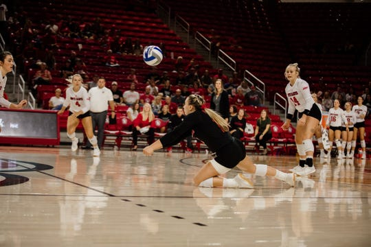USD defensive specialist Anne Rasmussen bumps the ball against Iowa.