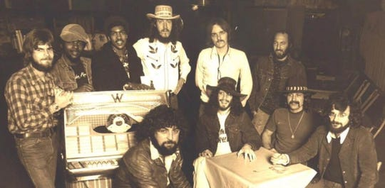 From the 1970s: Around the table, from left: Larry Getz, Rick Weaver, Charlie McCall and Carmine Delligatti. Back row: Jon R. Goin, Don Shipps, Frank Westbrook, Mike Bunge, Bill Jones and Benny Mahan.