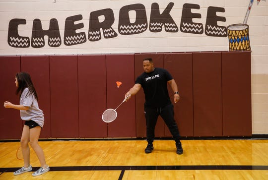 Springfield Police Officer Darrell Barge plays badminton with seventh-grade students at Cherokee Middle School as part of the SPD in PE program Wednesday.