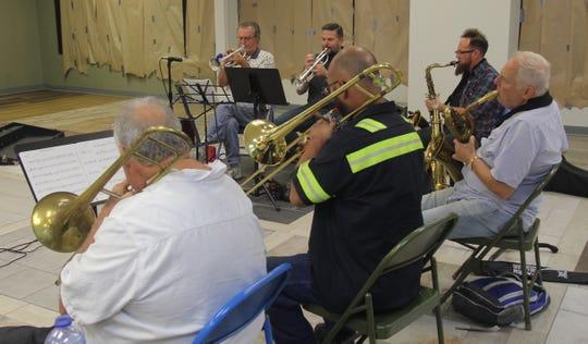 The horn section (from top left): Larry Getz, Corey Johnson, Ryan Dunn, Bill Jones, Chris Vanderpool and Rick Weaver.