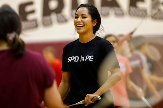 Springfield Police Department Public Information Officer Jasmine Bailey laughs as she plays badminton with seventh-graders at Cherokee Middle School as part of the SPD in PE program on Wednesday.