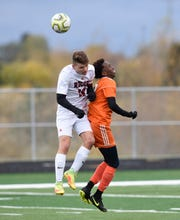 ROCORI's Joshua Johnston and Tech's Barkad Qasim battle for a header during the Section 8A semifinals Tuesday, Oct. 15, 2019, at Tech High School.