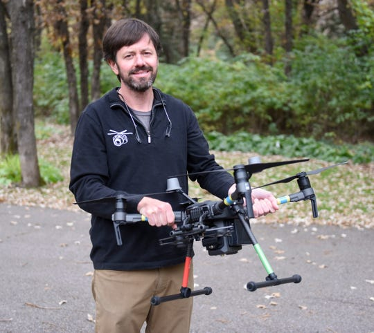 Steve Fines shows his drone that helped find missing 6-year-old Ethan Haus Wednesday, Oct. 16, 2019.