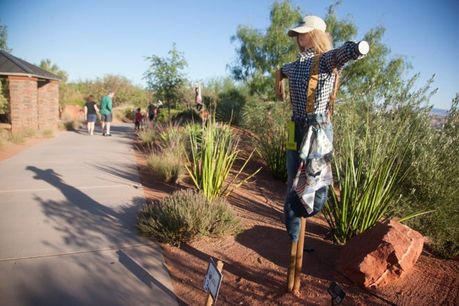 Community members gather for the fourth annual Scarecrow Walk and Haunted Canyon event at the Red Hills Desert Garden Tuesday, Oct. 15, 2019.