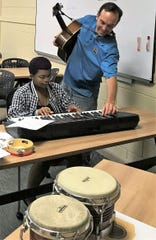 Mark Tancig, the Horticulture Agent and 4-H Music Club leader, and 4-H member, Arria Haigler, prepare to play a song together during 4-H Music Club.