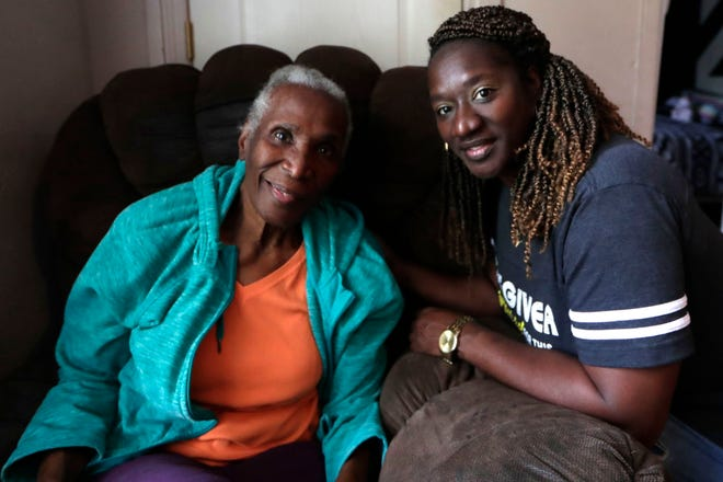 Vera Johnson, who was diagnosed with Alzheimer's in 2015, smiles for a photo with her daughter and caregiver Priscilla Jean-Louis.