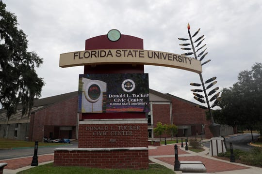 The Donald L. Tucker Center marquee and adjacent spear were both created by the FSU Master Craftsman Studio.