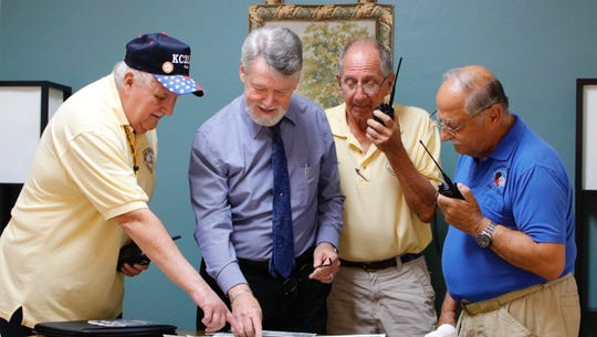 Vero Beach Centennial Parade Chairman John Michael Matthews, second from left,  meets with Paul J. Bartoszewicz, left, Dr. Bob Matusiak and Philip R. Mollica Jr., members of the Amateur Radio Club, to discuss the parade route and facilitating communication for the parade.