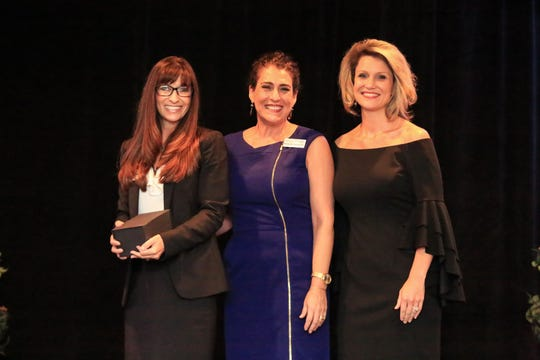 Elizabeth Barbella, left, Michelle Jacobs and Roxanne Hall at the 2018 National Philanthropy Day Awards for St. Lucie and Martin counties.