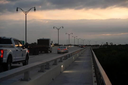 The sun rises over the Crosstown Parkway Bridge on Wednesday, Oct. 16, 2019, in Port St. Lucie. The six-lane, $91 million bridge opened Sept. 28 and is the final piece of the eight mile long parkway designed to connect Interstate 95 and U.S. 1. An estimated 40,000 vehicles will cross the bridge daily.